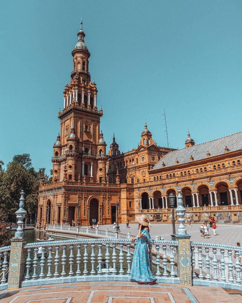 a girl standing in plaza de espana in seville spain