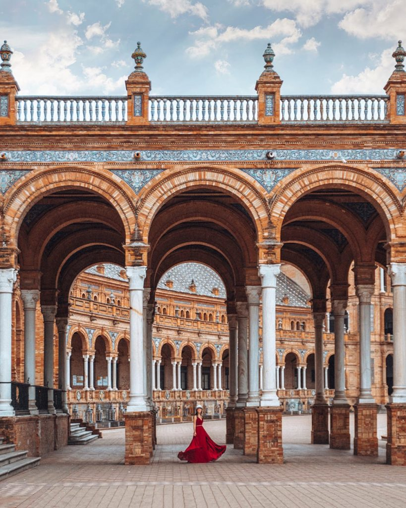girl standing inside plaza de espana in seville spain