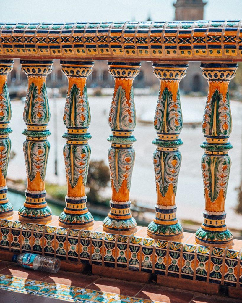 the railing of a bridge in plaza de espana in seville spain