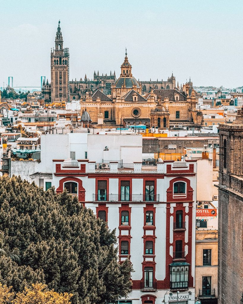 the view of the city of seville from a rooftop