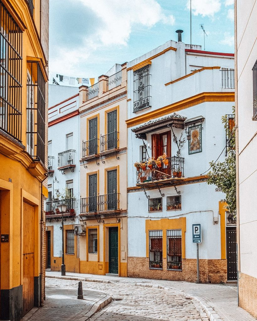 houses on a colorful street in seville spain