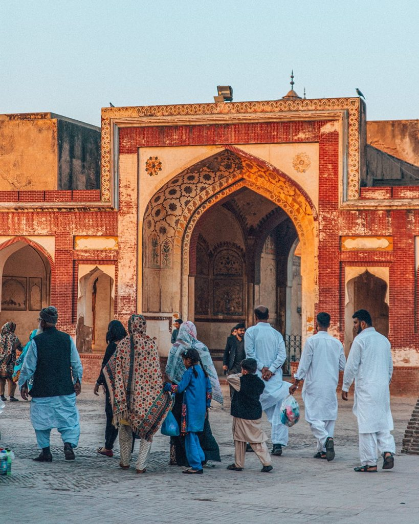 locals walking inside lahore fort in pakistan