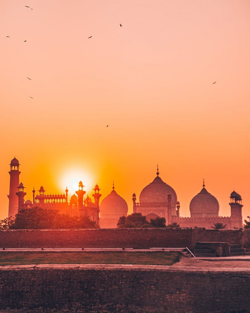 the view of badshahi mosque during sunset from lahore fort in pakistan