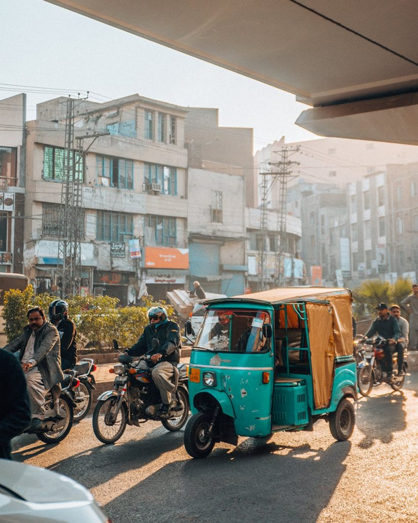 a rickshaw on a busy road in lahore pakistan