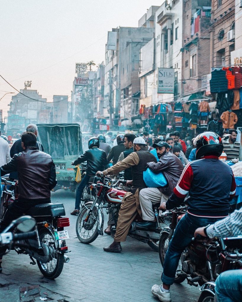 people riding motorcycles on a busy road in lahore pakistan