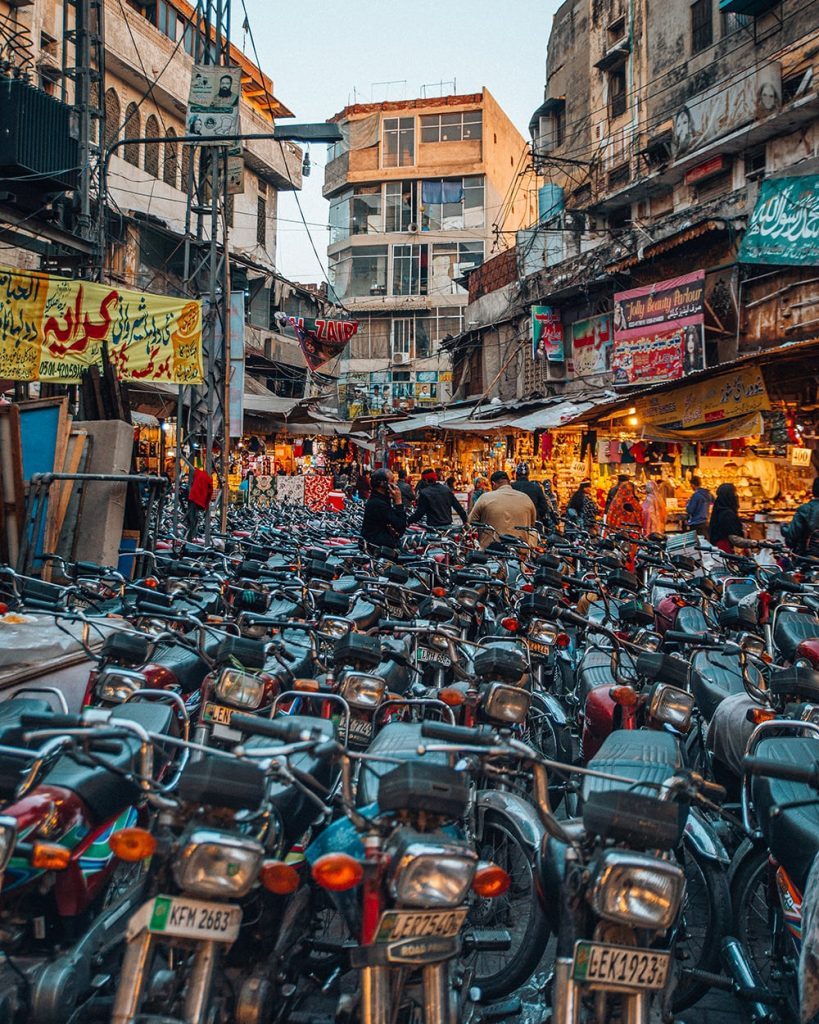 a cluster of bikes on a busy street in lahore pakistan