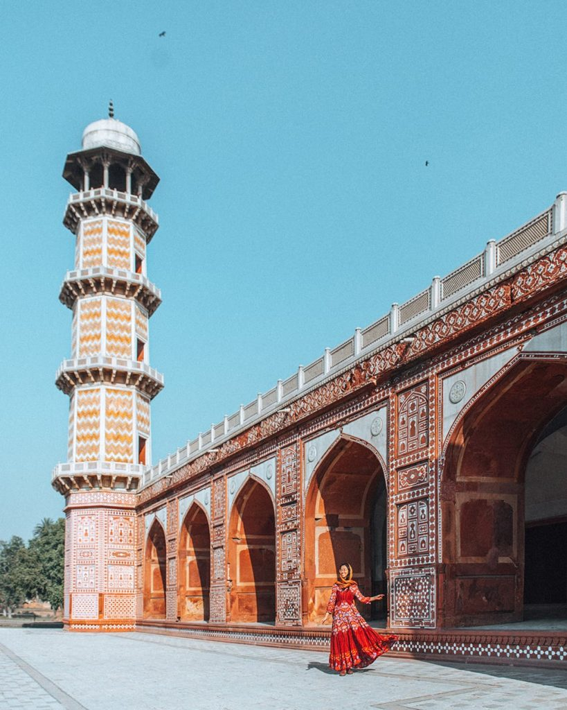 girl standing in front of tomb of jahangir in lahore pakistan