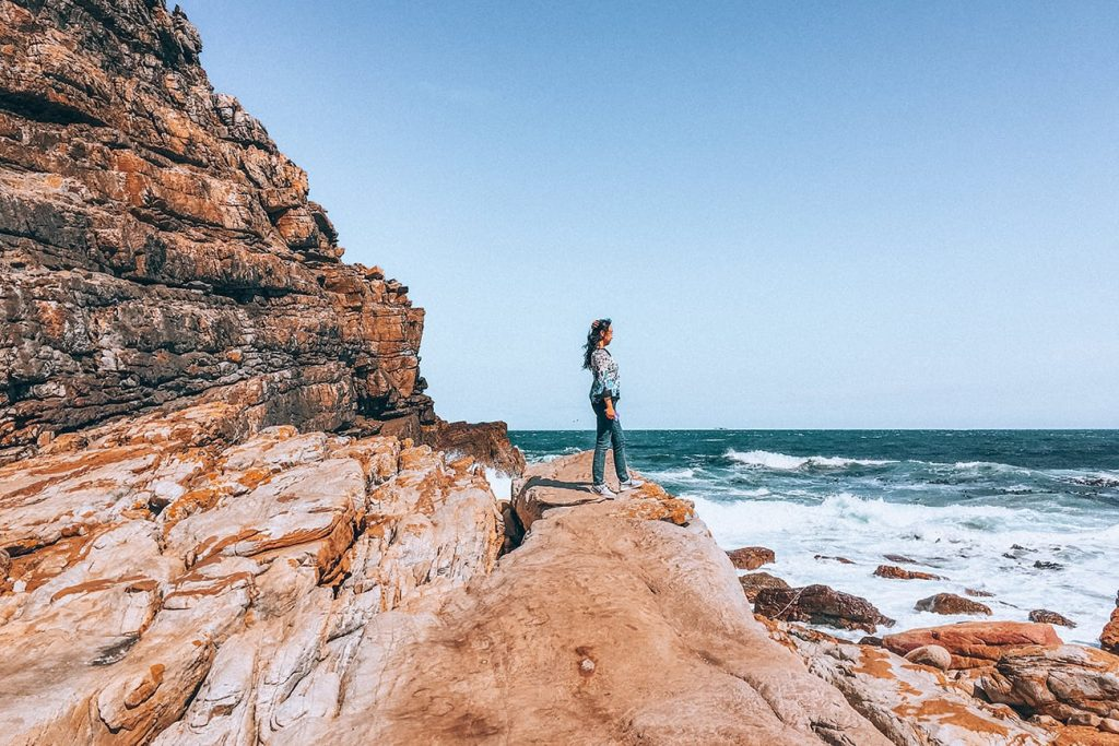 woman standing in cape of good hope in cape town south africa