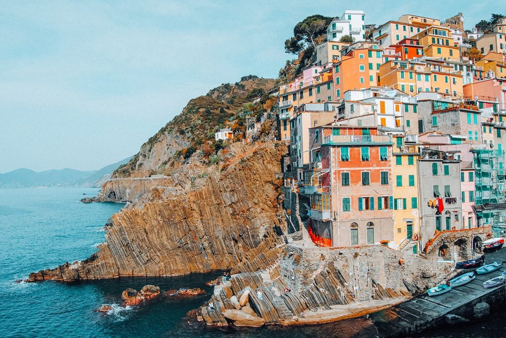 colorful houses by the coast in riomaggiore cinque terre italy