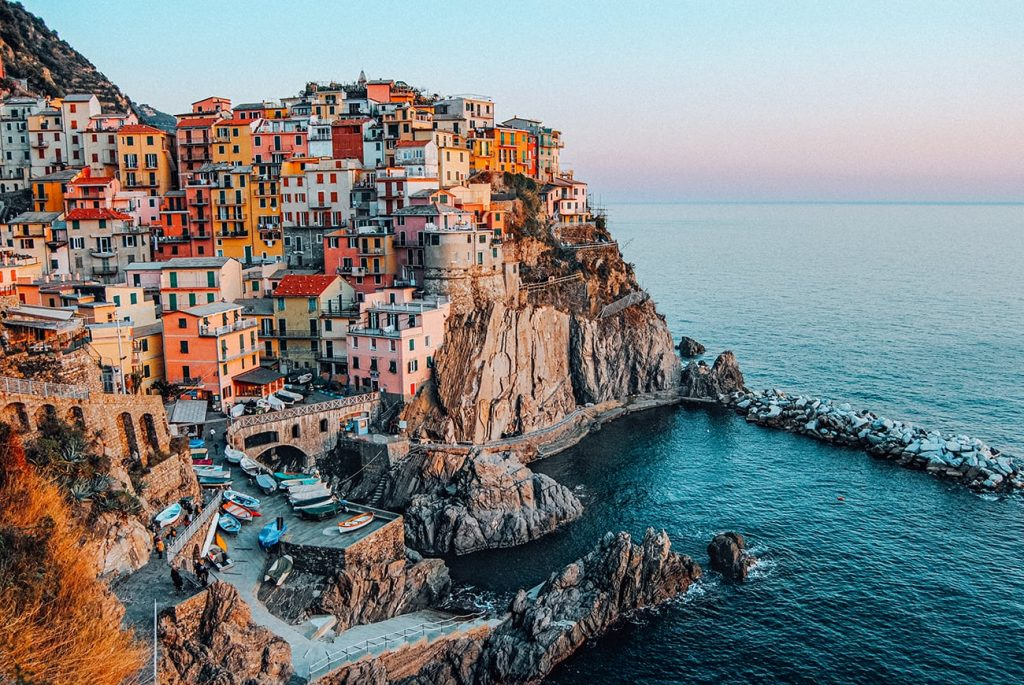 colorful houses by the coast in manarola cinque terre italy