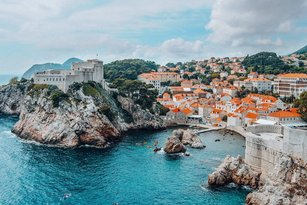 the seaside of dubrovnik croatia with houses and mountains in the backdrop