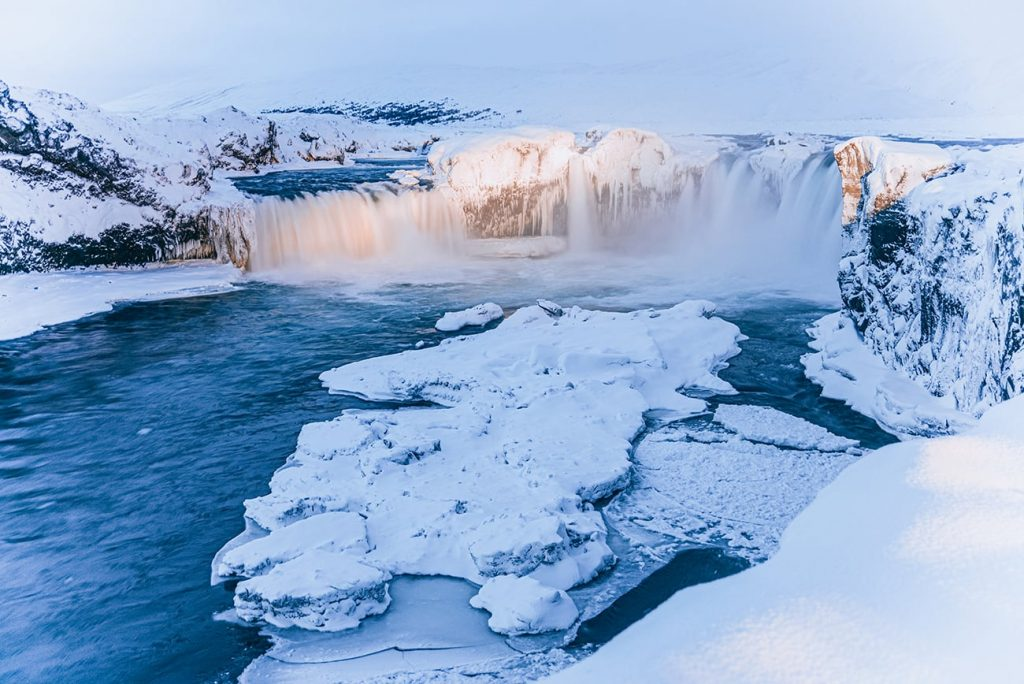 a frozen waterfall in iceland