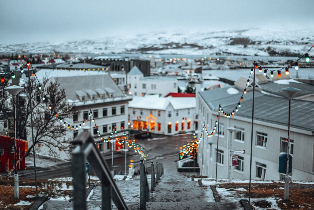 houses with christmas decorations in akureyri iceland