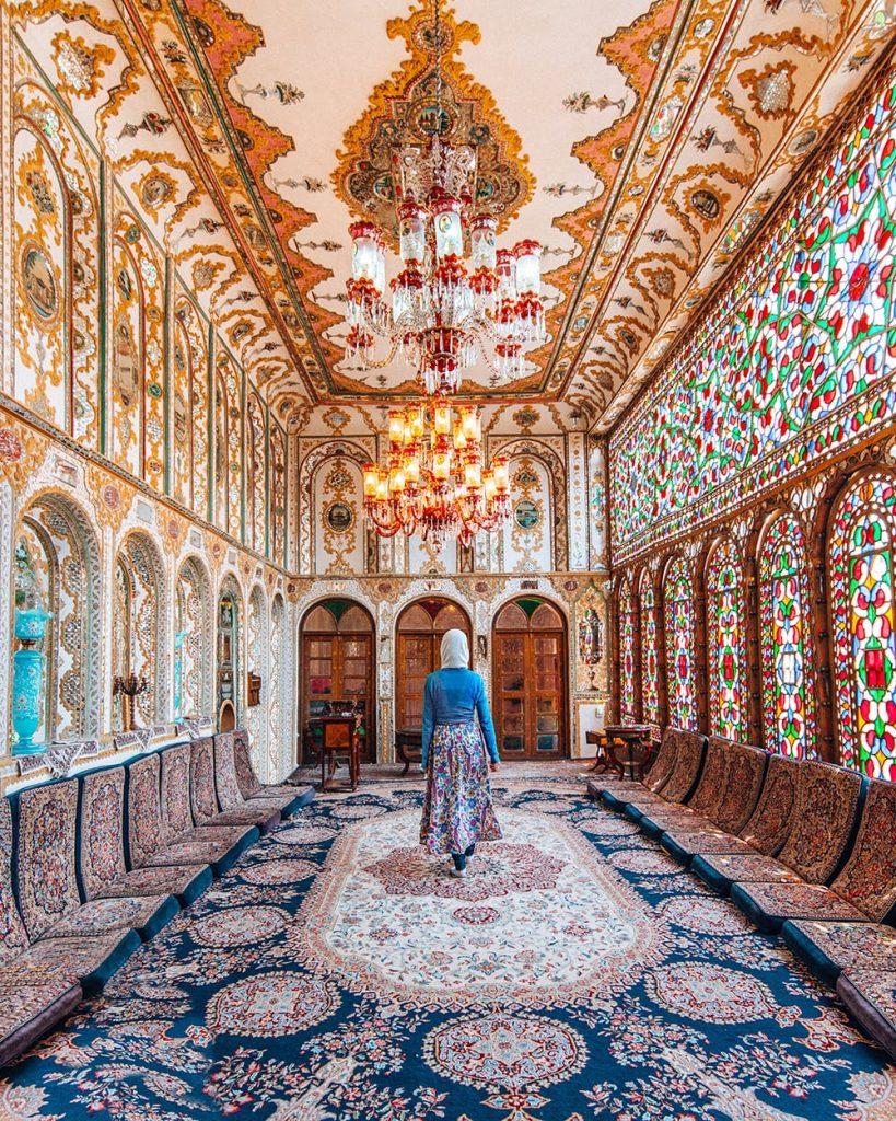 girl walking inside mollabashi house in esfahan iran