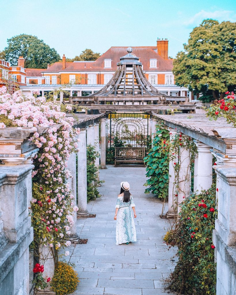 a girl walking inside pergola gardens in london