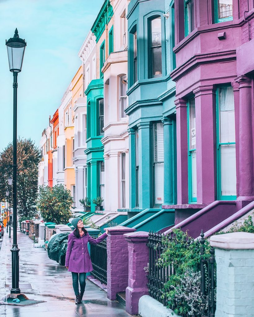 a girl wandering around the colorful streets of notting hill in london