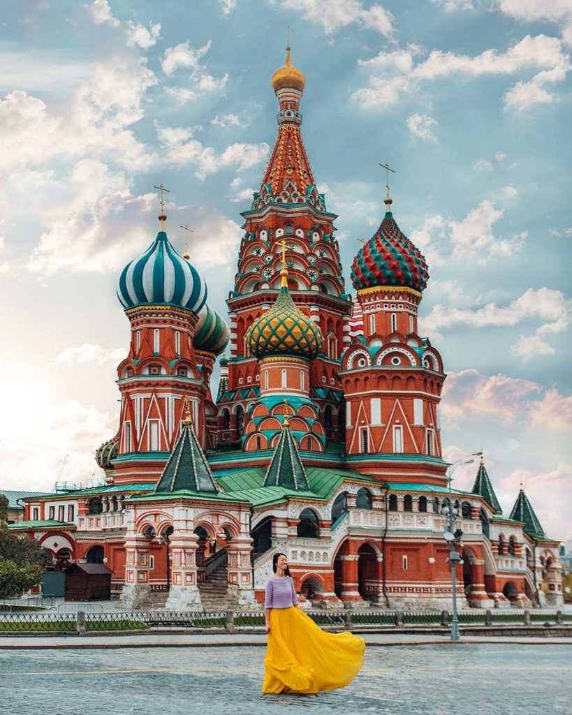 girl standing in St. Basil's Cathedral in moscow russia