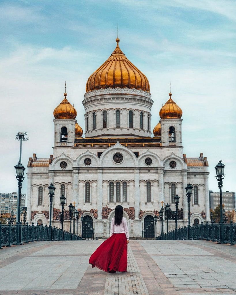 girl standing in front of Cathedral of Christ the Saviour in moscow russia