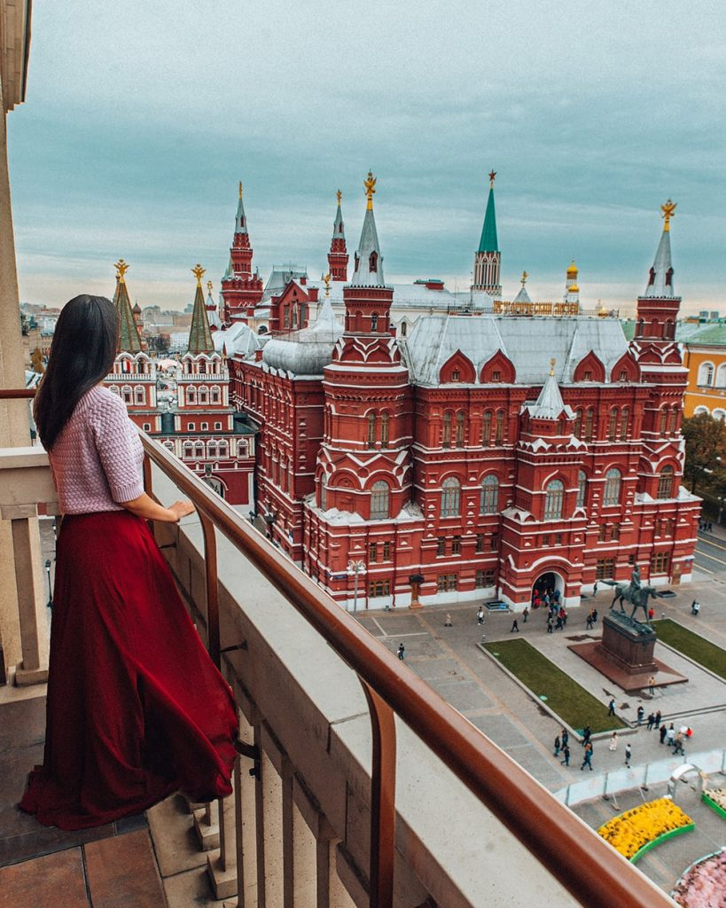 girl standing on the terrace of four seasons hotel in moscow russia