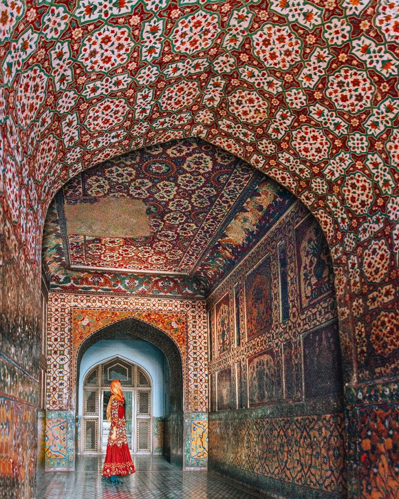 a girl standing inside jahangir tomb in lahore pakistan
