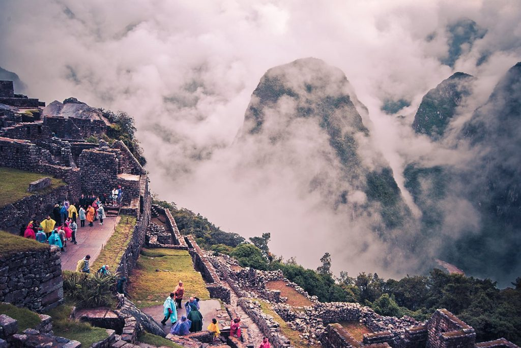 clouds over machu picchu in peru
