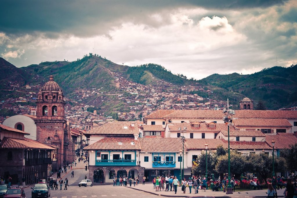 buildings in cuzco peru with a backdrop of mountains