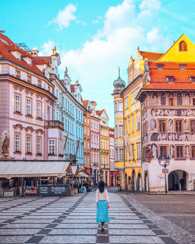 a girl walking in the colorful old town of prague czech republic