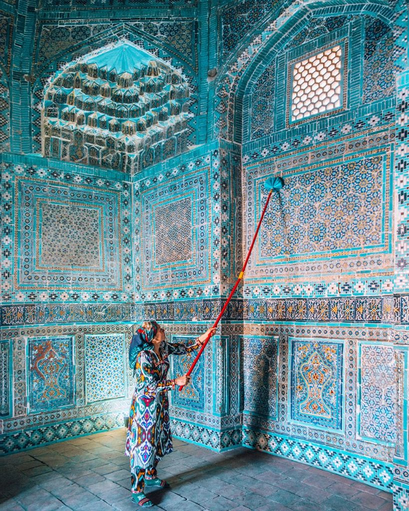 woman standing in shah i zinda mausoleums in samarkand uzbekistan