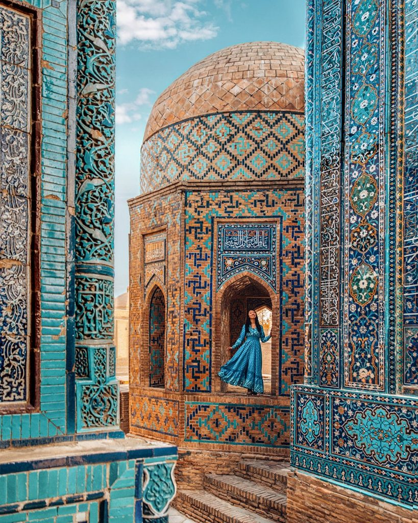 girl standing in shah i zinda mausoleums in samarkand uzbekistan
