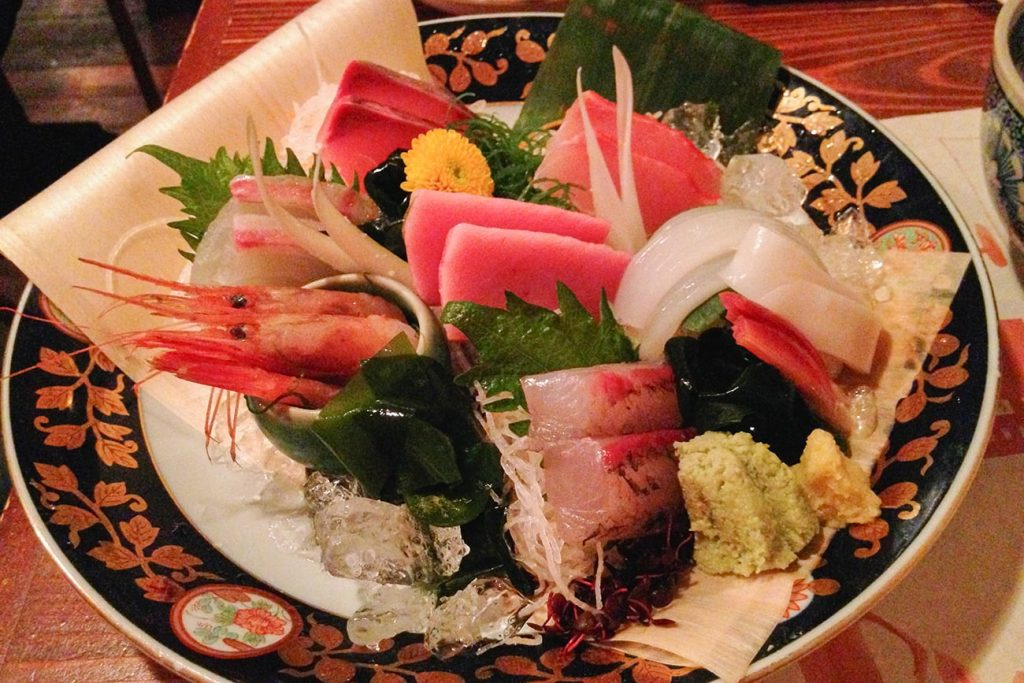 a plate of sashimi in a restaurant in tokyo japan