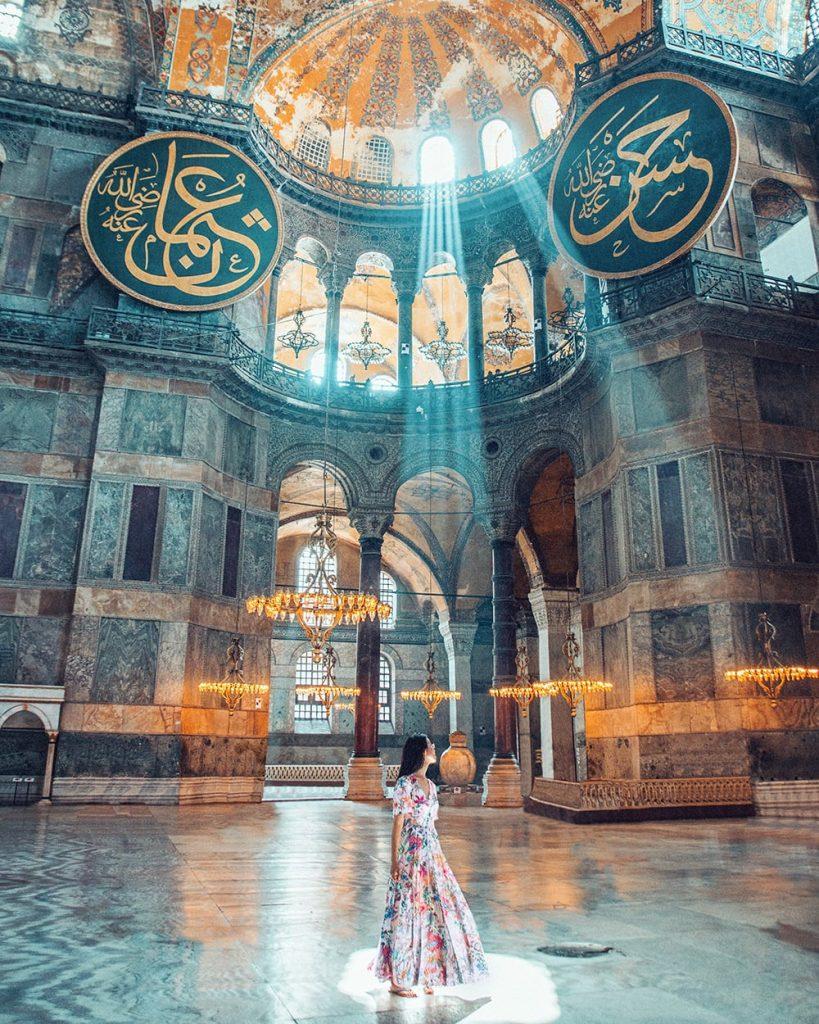 girl standing in hagia sophia museum in istanbul turkey