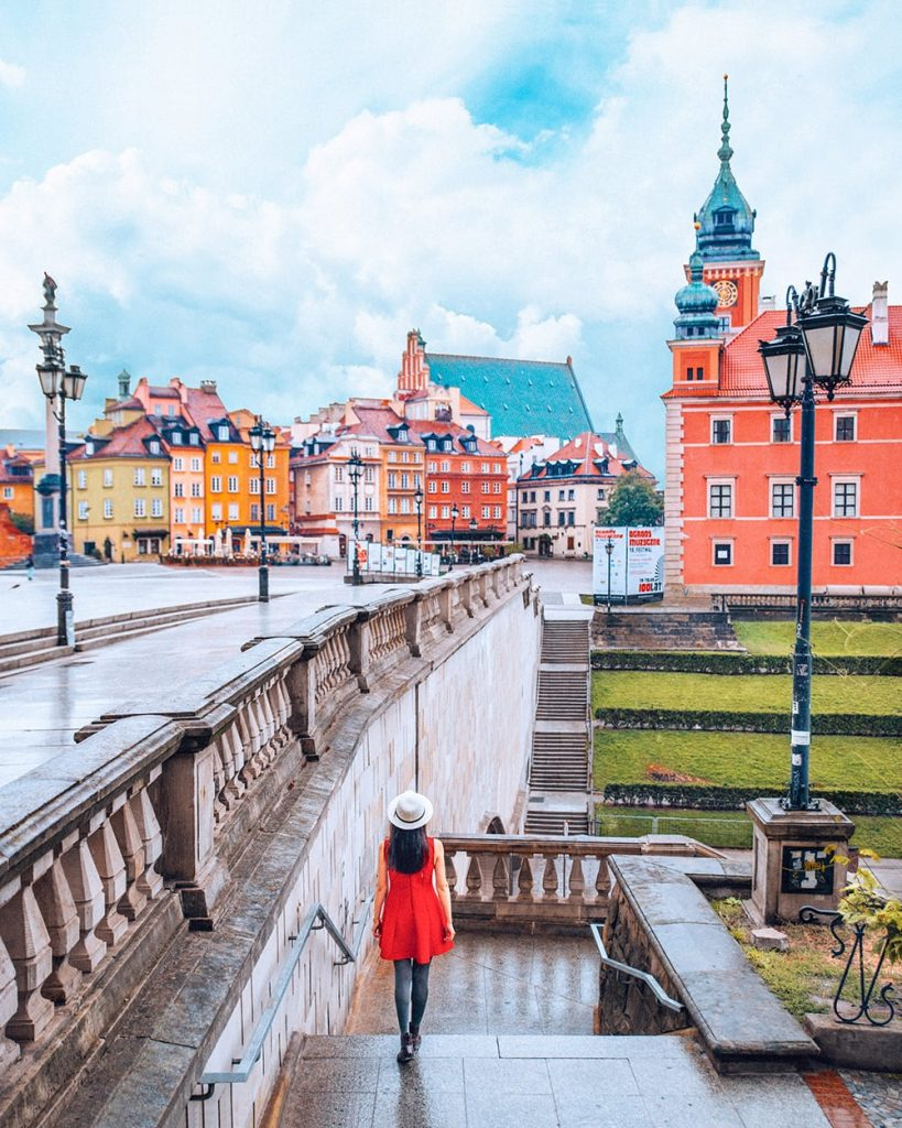 girl walking inside the old town of warsaw poland