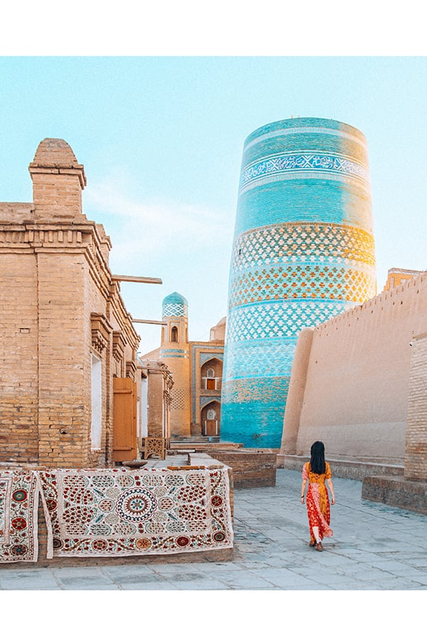 a girl walking in the old town of khiva uzbekistan