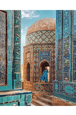 a girl standing in the shah i zinda necropolis in samarkand uzbekistan