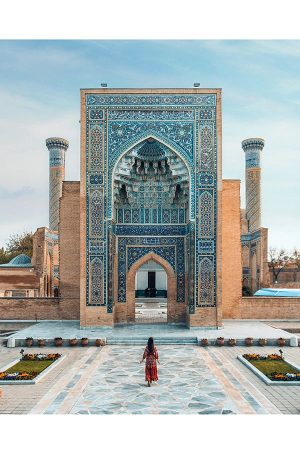 girl walking towards gur e amir mausoleum in samarkand uzbekistan