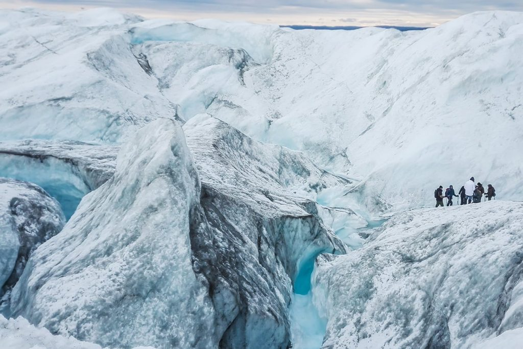 people walking on the Kangerlussuaq glacier in greenland