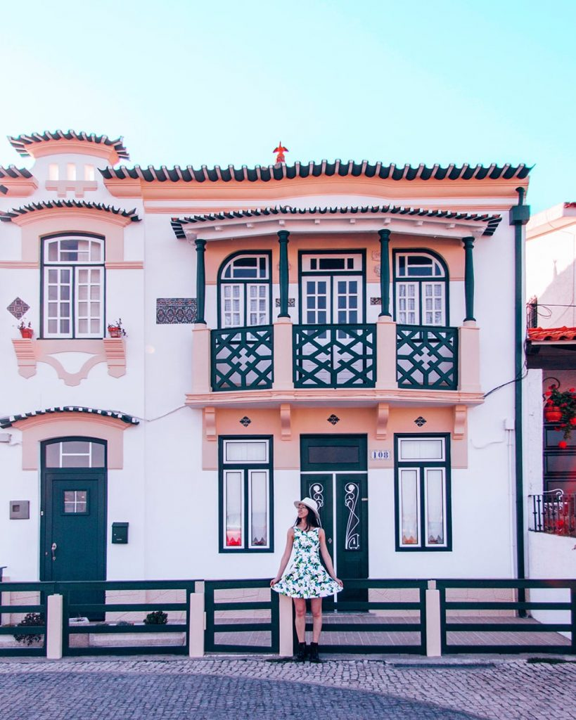 a colorful building in the fishing town of aveiro portugal