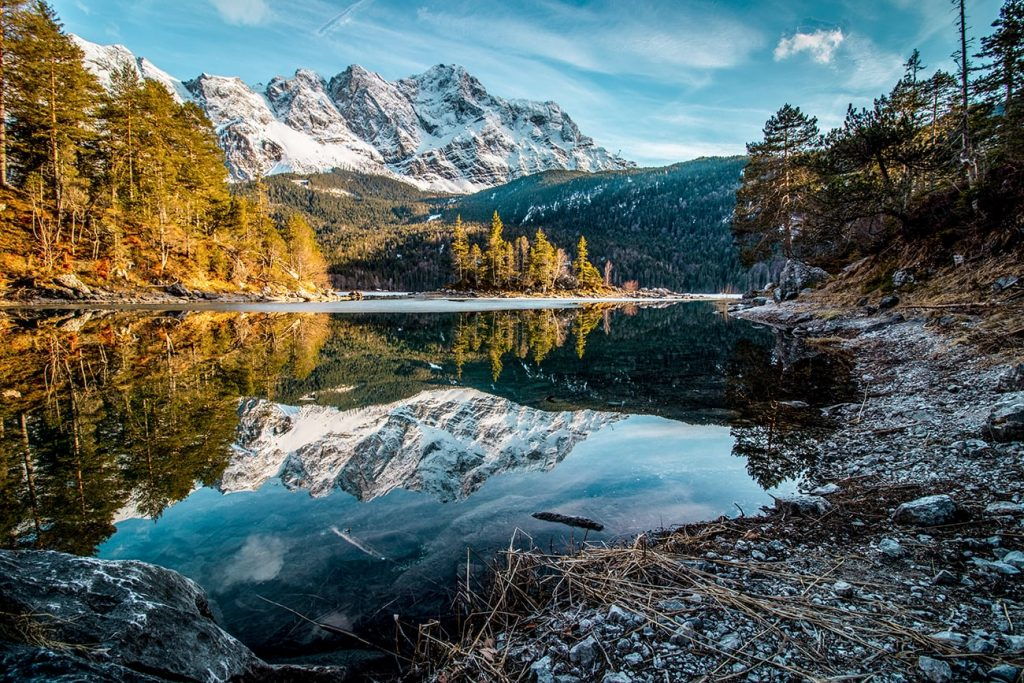 mountains and their reflections on eibsee lake in germany