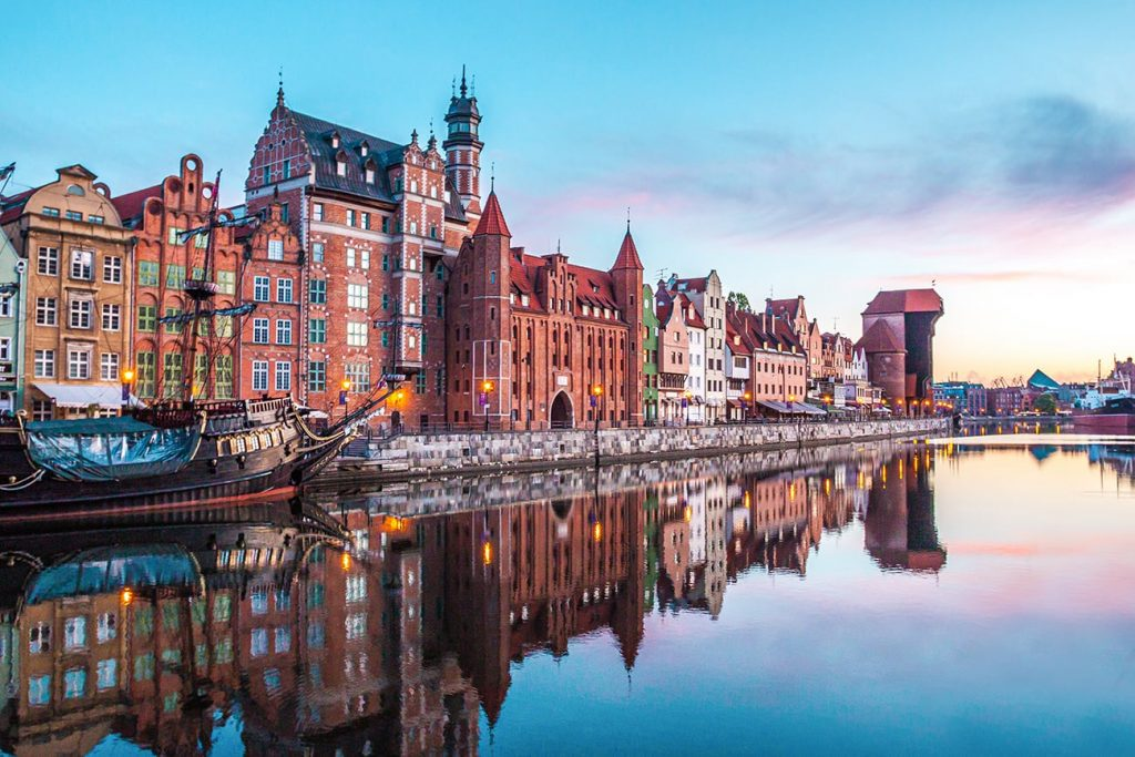 the buildings of gdansk poland reflecting in the water