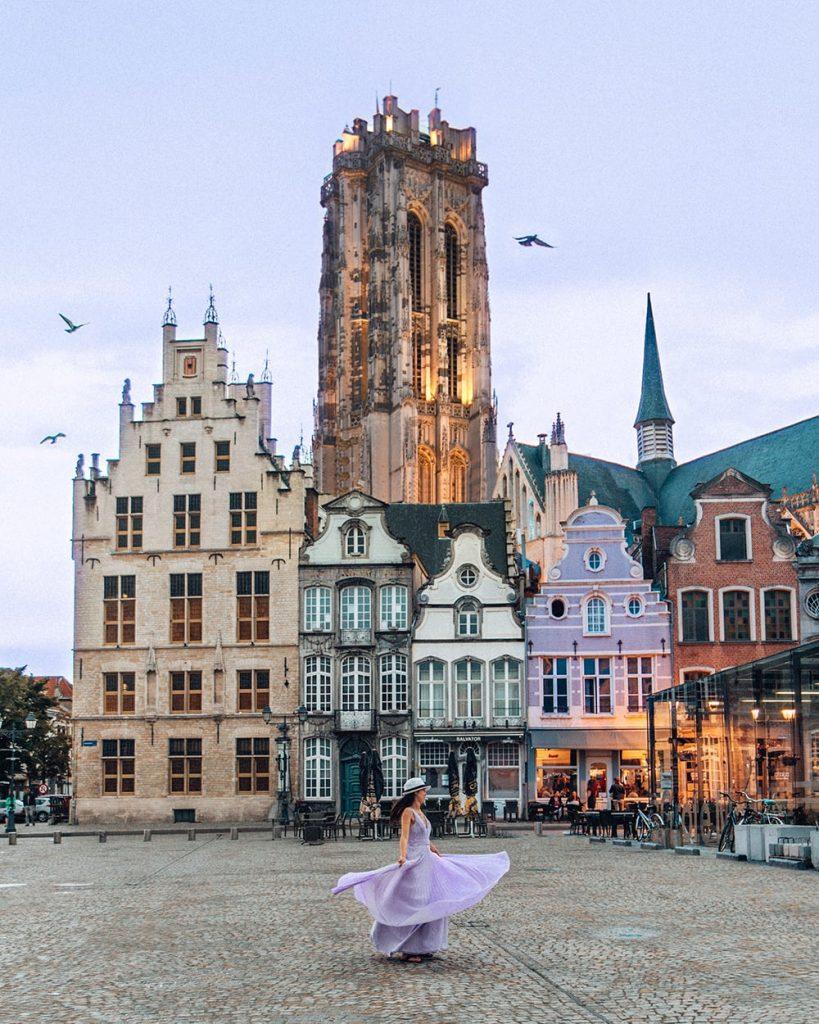 girl standing in grote markt in mechelen belgium