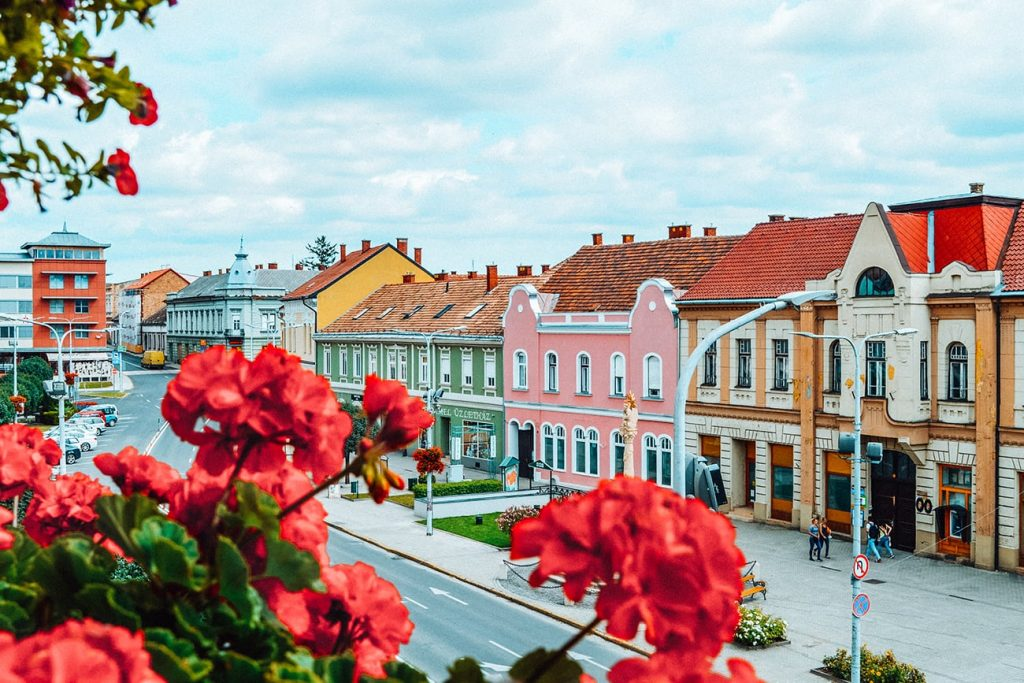 colorful houses and flowers in tapolca hungary