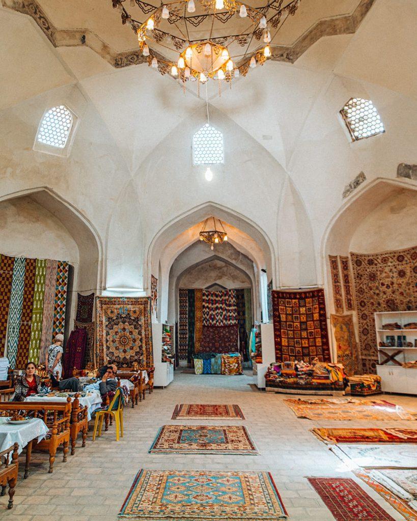 a bazaar selling carpets in uzbekistan