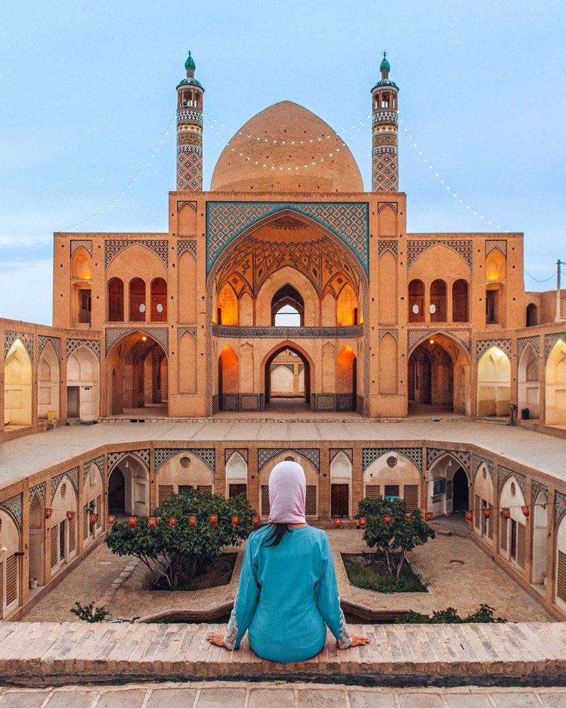 A Girl Sitting In Front Of Agha Bozorg Mosque in Kashan, Iran