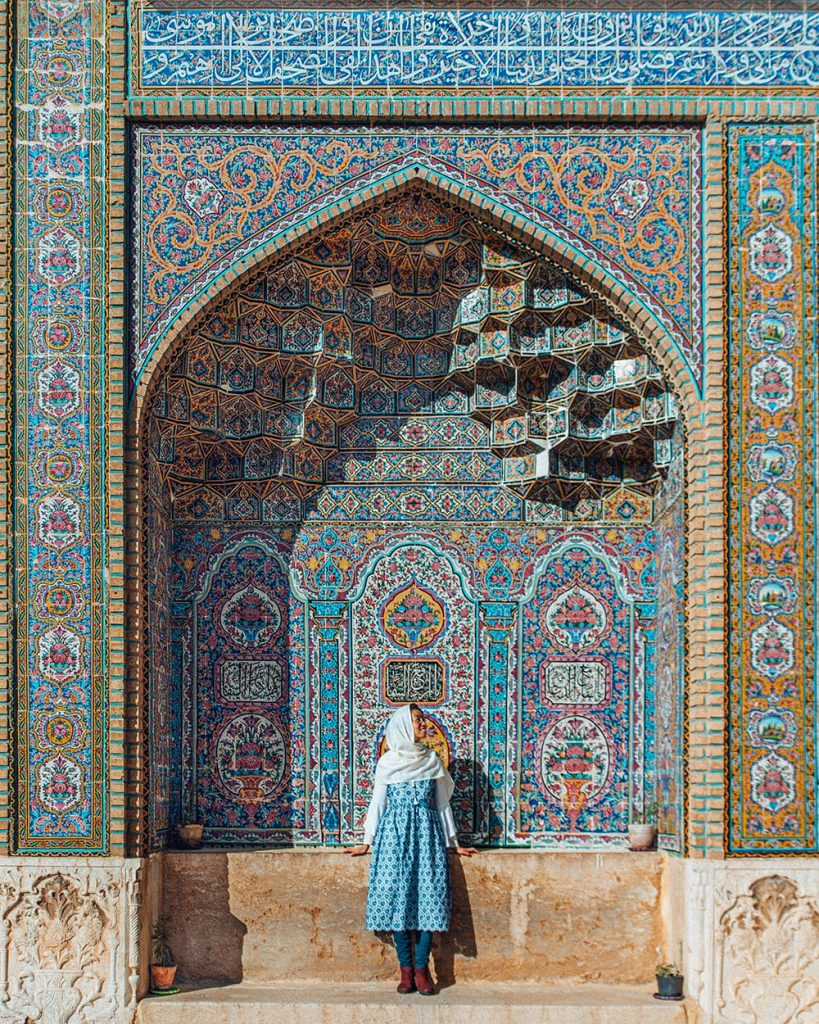 A Girl Standing Next to the Tilework of the Pink Mosque in Shiraz, Iran