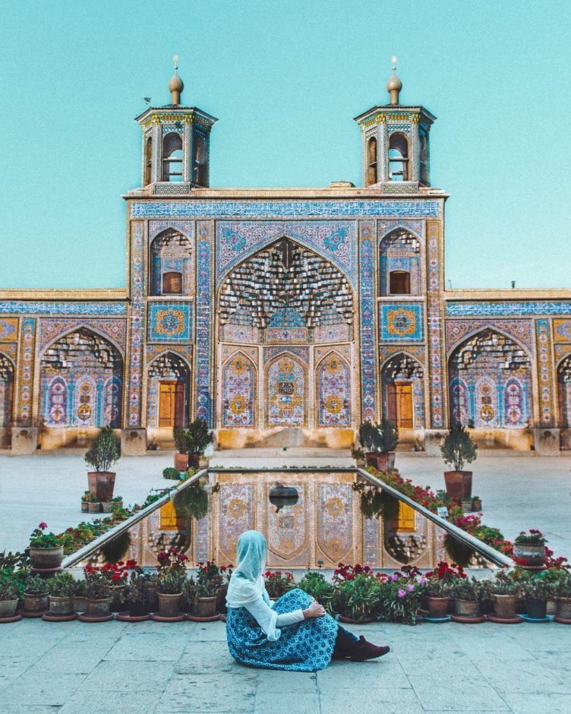 A Girl Sitting in Front of the Pink Mosque Pond in Shiraz, Iran
