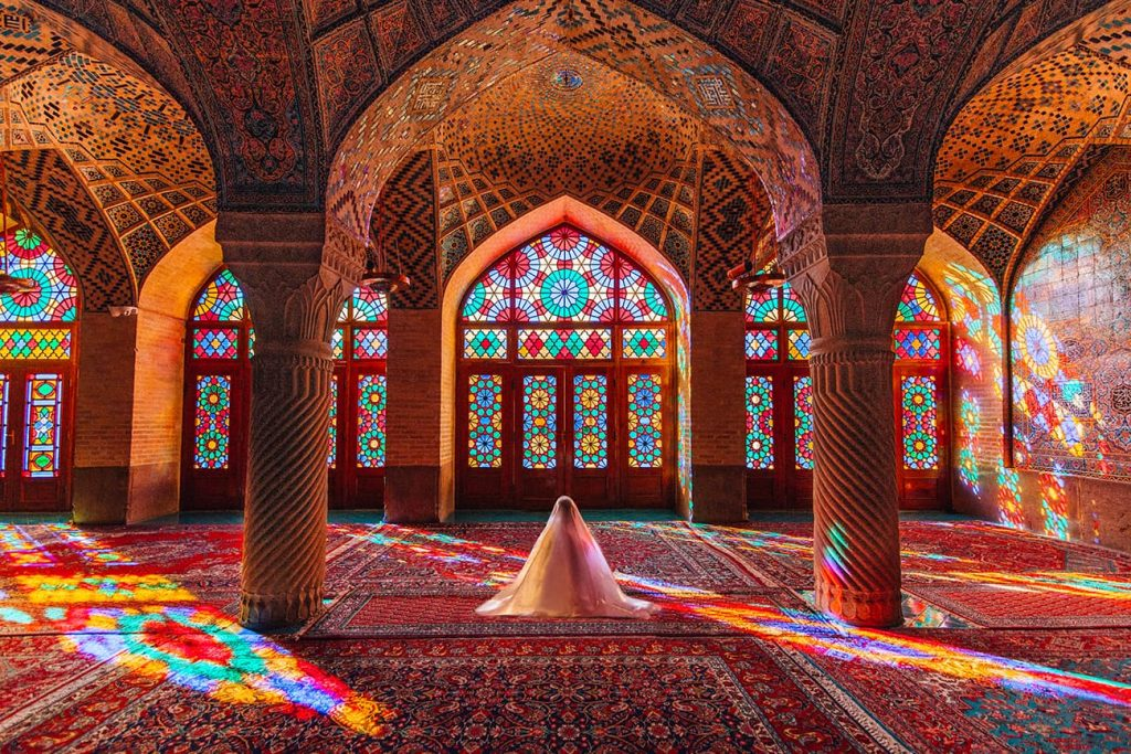 A Girl Sitting Inside the Pink Mosque in Shiraz, Iran
