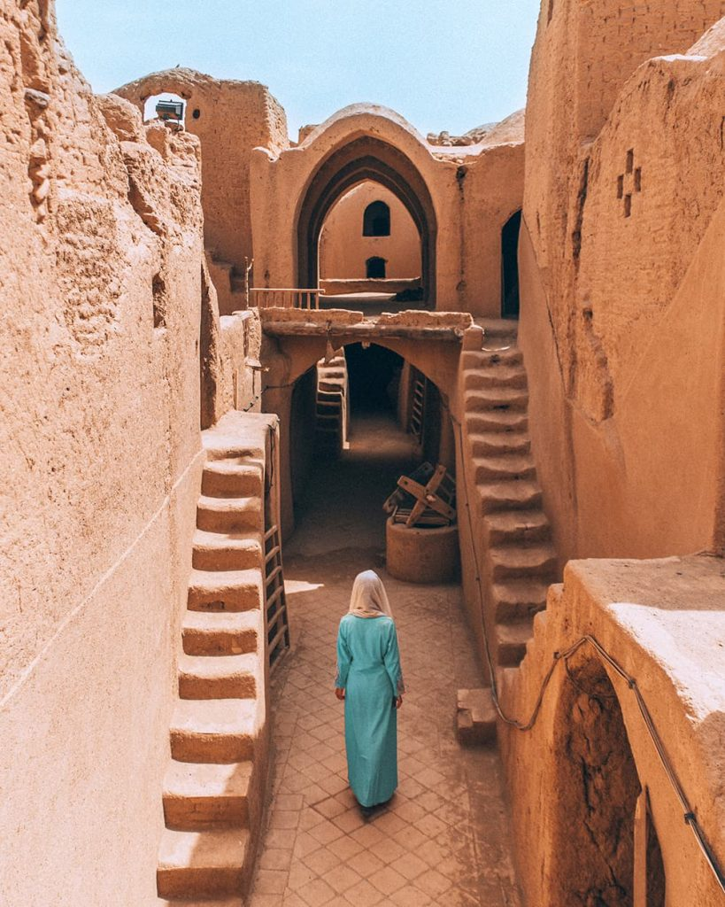 A Girl Walking Inside Sar Yazd Castle in Yazd, Iran