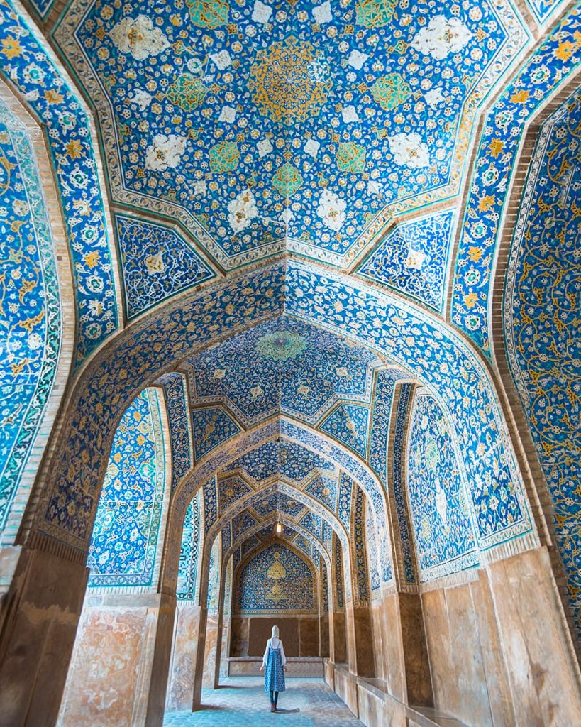A Girl Walking Inside Shah Mosque in Isfahan, Iran