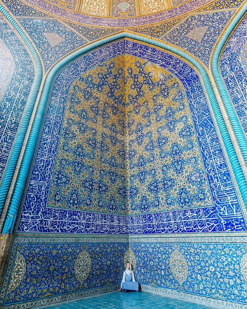 A Girl Sitting Inside Sheikh Lotfollah Mosque in Isfahan, Iran