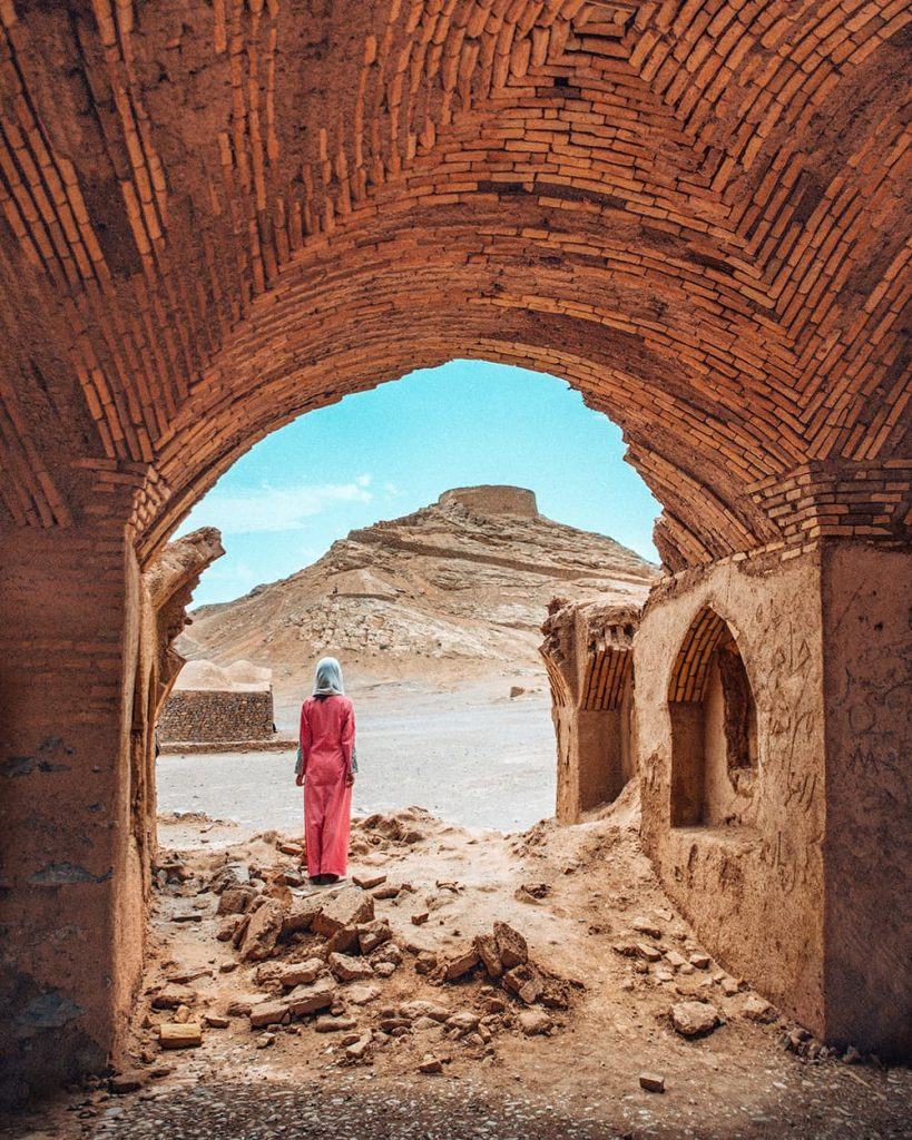 A Girl Standing Inside the Zoroastrian Towers of Silence in Yazd, Iran